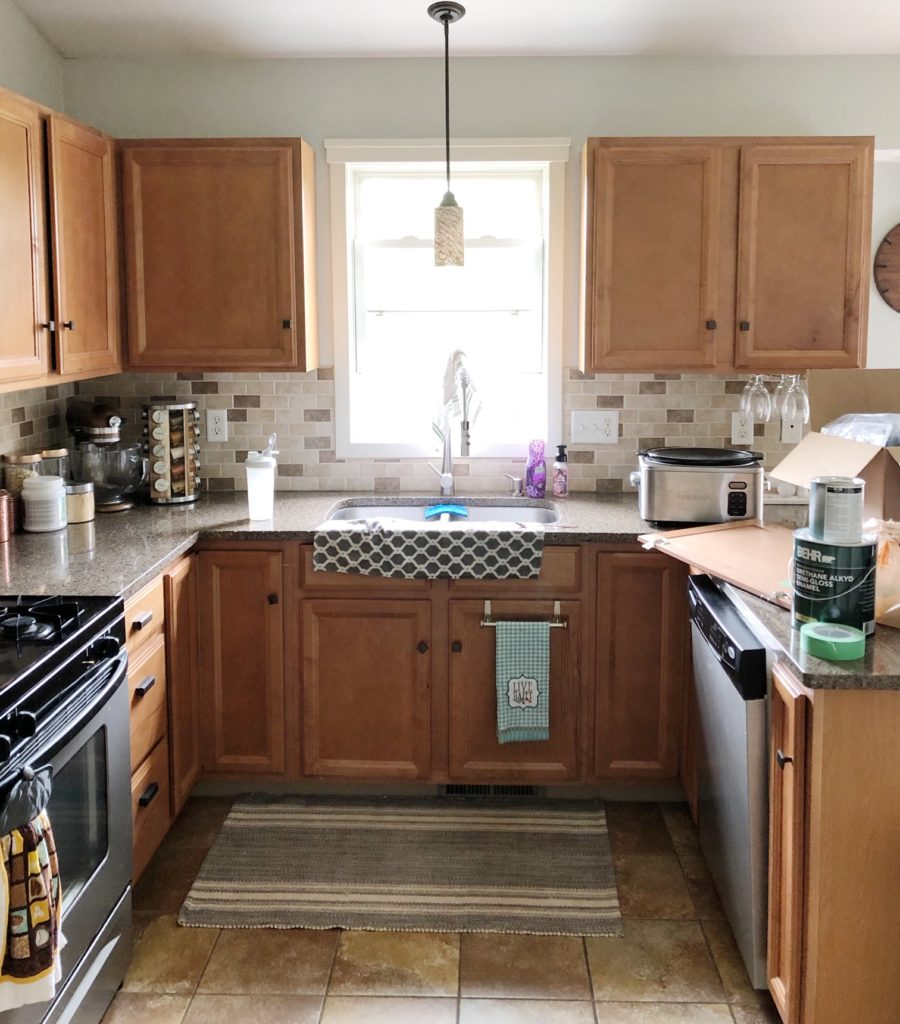 Painting Your Builder Grade Kitchen Cabinets | Renovating ...